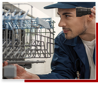 plumber inspecting dishwasher