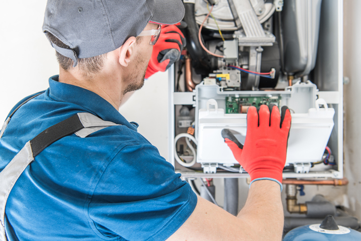 technician performing heating repair in torrance ca